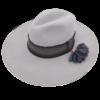 Ninakuru long brim wool hat with grosgrain ribbon, zig zag stitch. Dark brown leather band with wool tassel and gold. Cotton interior band.