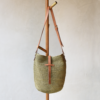Ninakuru agave crossbody bag, crochet agave straw. Leather strap tan with bronze buckle
